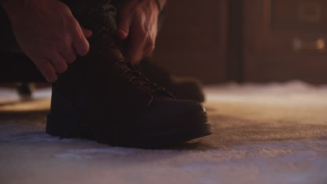 close-up man ties laces on his boots. - boot stock videos & royalty-free footage