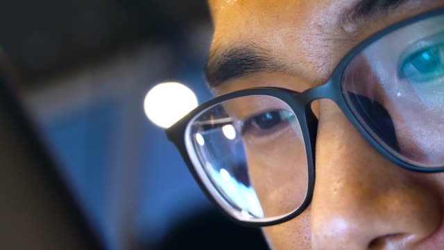 close-up man with eyeglasses using mobile phone - spectacles stock videos & royalty-free footage