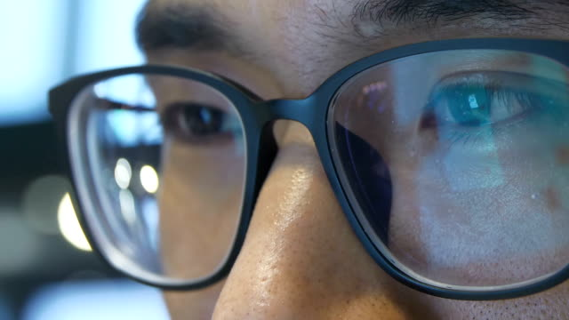 close-up man with eyeglasses using mobile phone - projection screen stock videos & royalty-free footage