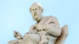 Closeup Marble Statue of the Ancient Greek Philosopher Plato in Motion