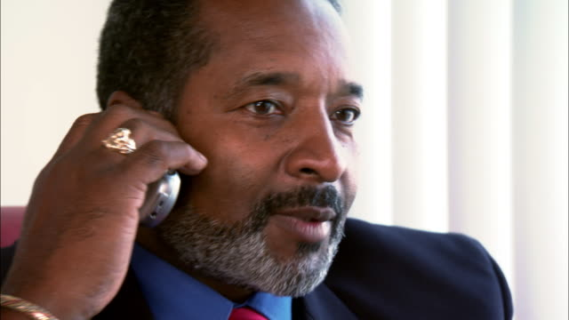 close-up mature businessman talking on cell phone in office - goatee stock videos & royalty-free footage