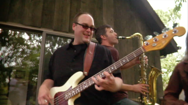 close-up - medium shot band performing at backyard party/ oshkosh, wisconsin, usa - decking stock videos & royalty-free footage