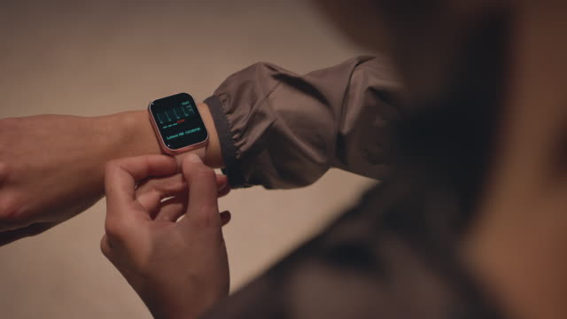 close-up midsection of woman using smart watch - wrist watch stock videos & royalty-free footage