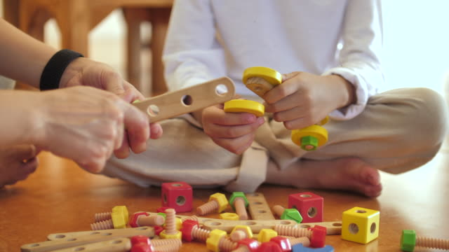 close-up mother and child little boy playing toy - family with one child stock videos & royalty-free footage