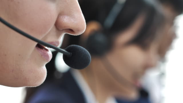 close-up mouth young call center agent working in an office - microphone stock videos & royalty-free footage