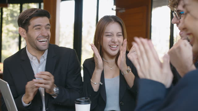 close-up multi-ethnic group of business people celebrating their success - excitement stock videos & royalty-free footage
