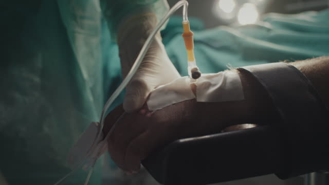 close-up, nurse holding patient's hand - glove video stock e b–roll