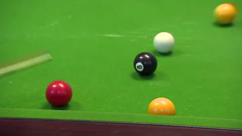 close-up of 8-ball pool being played - キューボール点の映像素材/bロール