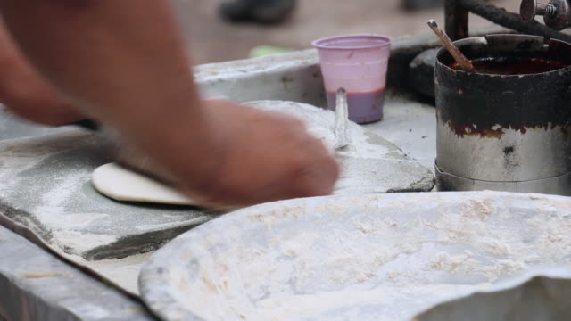 Close-up of a adult man making chapatti, Delhi, India