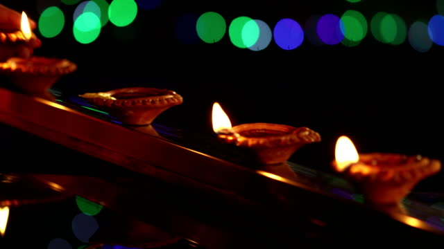 close-up of a adult woman celebrating diwali festival, delhi, india - oil lamp stock videos & royalty-free footage