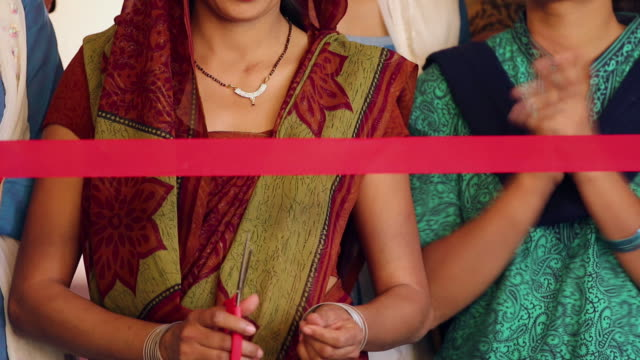 close-up of a adult woman cutting ribbon with a scissor, sonipat, haryana, india - opening ceremony stock videos & royalty-free footage