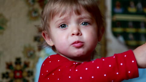 close-up of a baby chewing cookie and pointing to the right side - babies only stock videos & royalty-free footage
