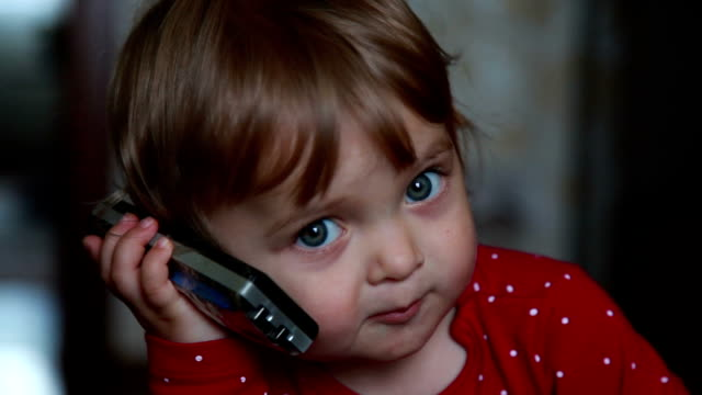 close-up of a baby talks on the phone - one baby girl only stock videos & royalty-free footage