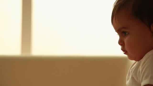 close-up of a baby - ein männliches baby allein stock-videos und b-roll-filmmaterial