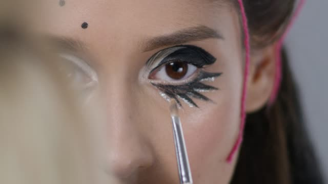close-up of a backstage. make-up artist puts eyeshadows on fashion model`s eyes. fashion video. - backstage stock videos and b-roll footage