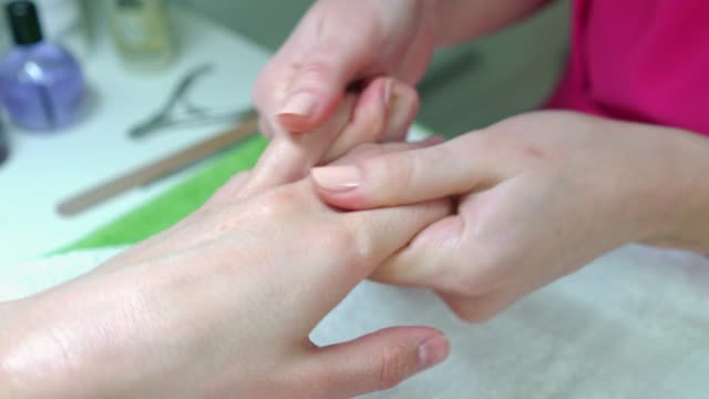 close-up of a beautician massaging costumer hands - manicure - manicure stock videos & royalty-free footage