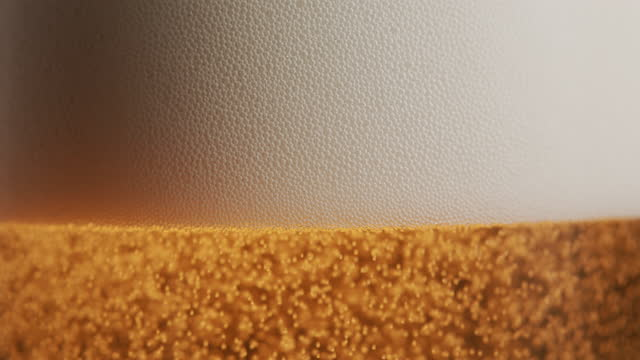 close-up of a beer glass with foam and small air bubbles - frothy drink stock videos & royalty-free footage