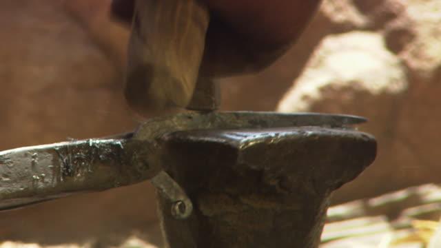 Close-up of a blacksmith forging metal
