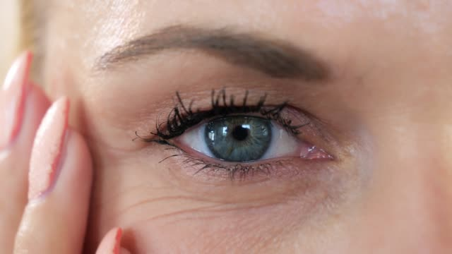 close-up of a blue eyed woman with little makeup - no make up stock videos & royalty-free footage