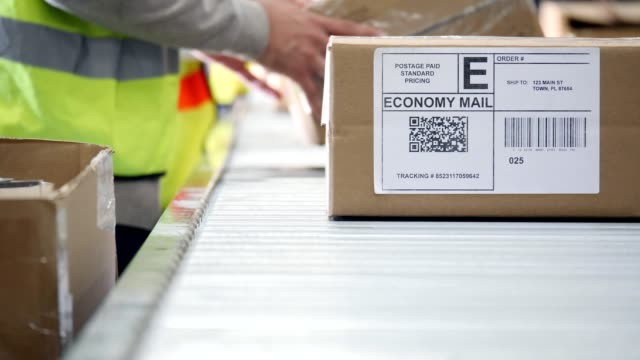 closeup of a box prepared for delivery in distribution warehouse - e commerce stock videos & royalty-free footage