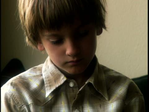 close-up of a boy playing a video game - korta ärmar bildbanksvideor och videomaterial från bakom kulisserna