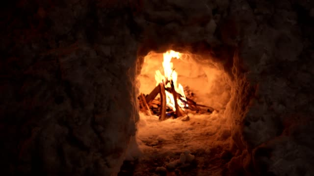 close-up of a bright bonfire burning inside of an igloo - igloo stock videos & royalty-free footage