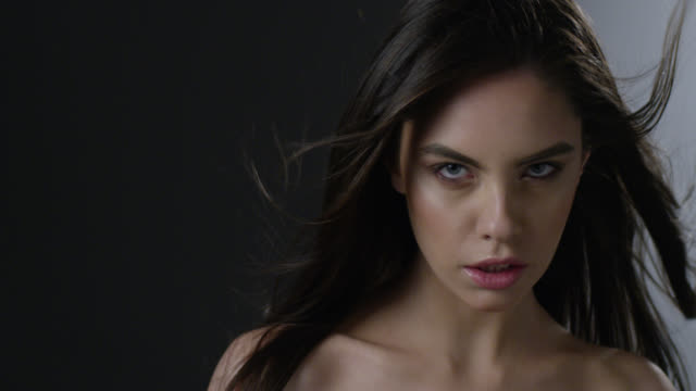 close-up of a brunette fashion model`s face. fashion video. - haute couture stock videos and b-roll footage