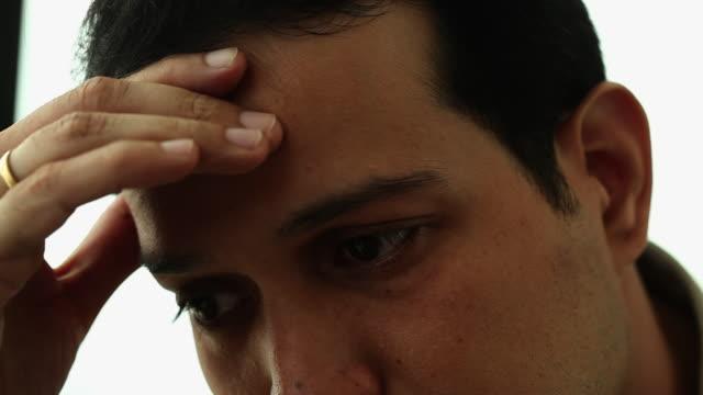 Close-up of a businessman looking sad