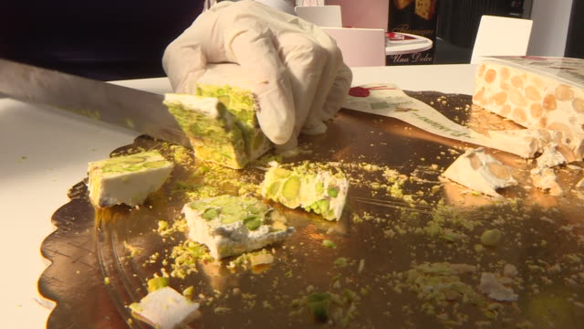 closeup of a cheesemonger cutting cheese - kitchen knife stock videos & royalty-free footage