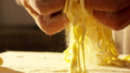 Close-up of a chef preparing ravioli, a typical Italian dish, homemade according to the ancient Italian tradition.