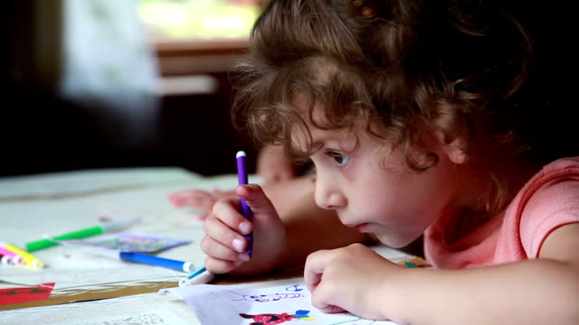 Close-up of a child drawing from life
