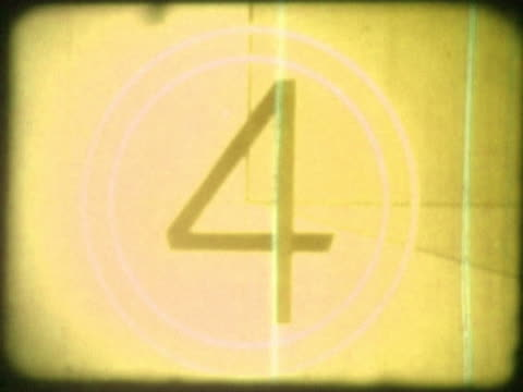 close-up of a countdown on a film leader - nummer 4 bildbanksvideor och videomaterial från bakom kulisserna