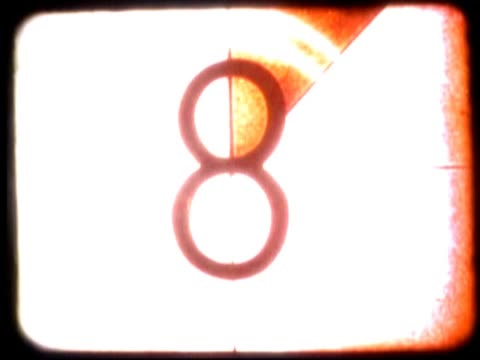 vidéos et rushes de close-up of a countdown on a film leader - chiffre 8