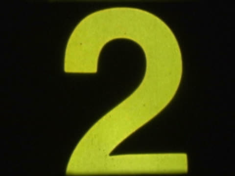close-up of a countdown on a film leader - ビネット点の映像素材/bロール