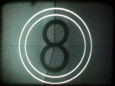 close-up of a countdown on a film leader - 数字の6点の映像素材/bロール