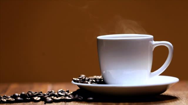 close-up of a cup of coffee - 茶色背景点の映像素材/bロール