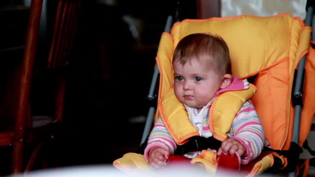 close-up of a curious baby sitting in the pram - one baby girl only stock videos & royalty-free footage