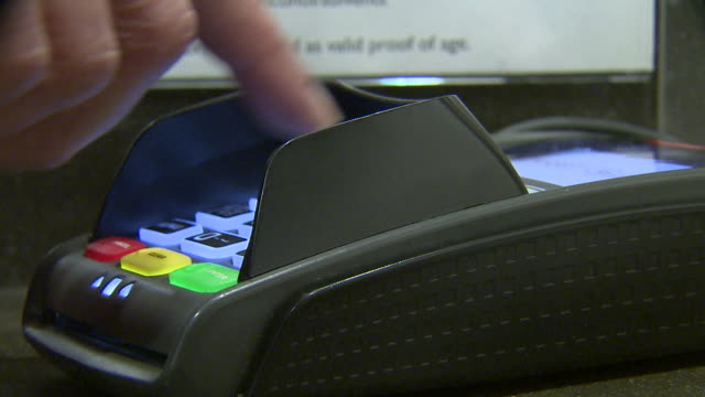 closeup of a customer typing their pin into a card reader - paying stock videos & royalty-free footage