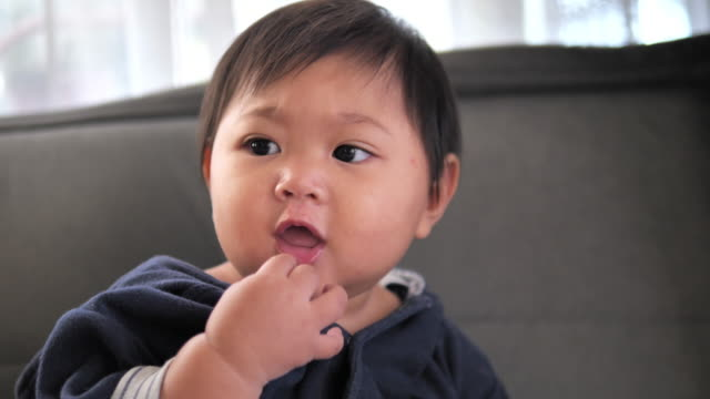 close-up of a cute baby's face with beautiful - babies only stock videos & royalty-free footage