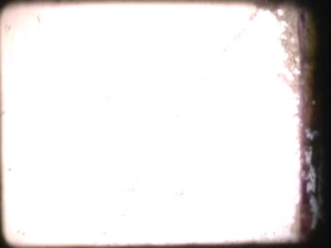 vídeos de stock e filmes b-roll de close-up of a damaged film leader - super exposto