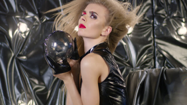 close-up of a fashion model holding light bulb. fashion video. - haute couture stock videos and b-roll footage