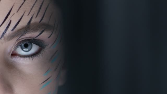 close-up of a fashion model`s blue eye. fashion video. - stage make up stock videos and b-roll footage