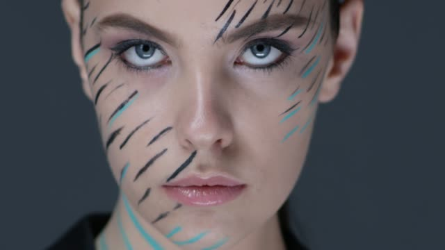close-up of a fashion model`s blue eye. fashion video. - illustration technique stock videos & royalty-free footage