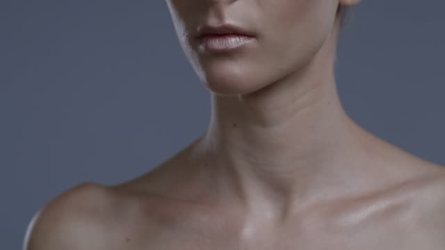 close-up of a fashion model`s lower part of a face. fashion video. - neck stock videos & royalty-free footage
