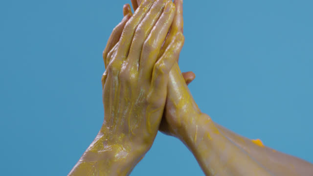 close-up of a fashion models`hands painted yellow on blue background. fashion video. - greasepaint stock videos and b-roll footage