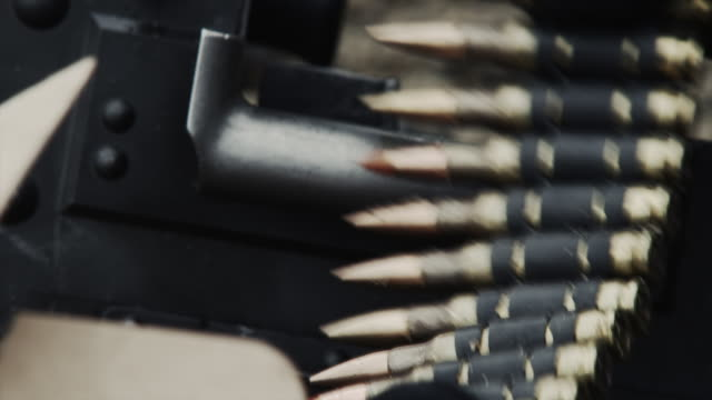 close-up of a feed tray of a belt-fed machine gun. - machine gun stock videos & royalty-free footage