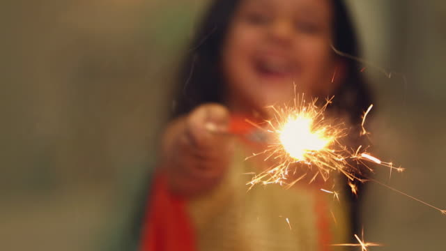 Close-up of a girl celebrating diwali festival