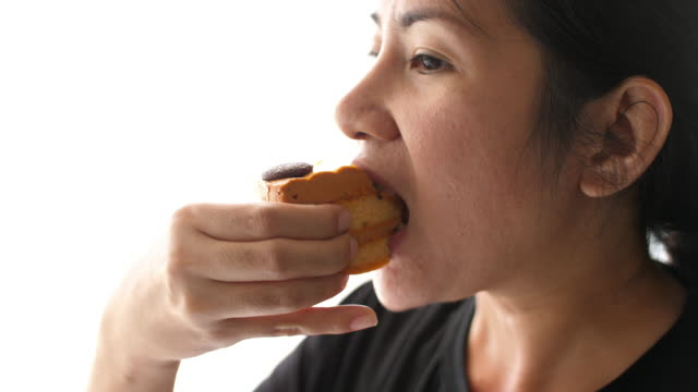 Close-up of a girl eating a cake