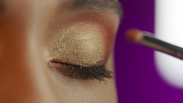 close-up of a girl eyes, make-up artist applies eyeshadow with a make-up brush. - make up stock videos & royalty-free footage