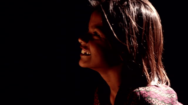 close-up of a girl smiling - side lit stock videos & royalty-free footage